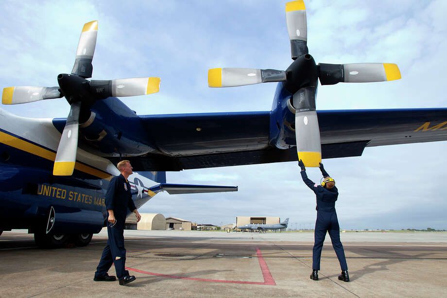 Marine Blue Angels Gunnery Seargeant Micah Bachtold, left watches as Staff Seargeant Adam Miller stops a prop after a flight aboard the Blue Angel's Fat Albert C130 airplane at Ellington Field Friday, Oct. 26, 2012, in Houston. Photo: Cody Duty, Houston Chronicle / © 2012 Houston Chronicle
