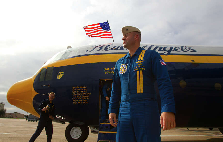 Marine Blue Angel Captain A.J. Harrell, right, looks out after a flight aboard the Blue Angel's Fat Albert C130 airplane at Ellington Field Friday, Oct. 26, 2012, in Houston. Photo: Cody Duty, Houston Chronicle / © 2012 Houston Chronicle
