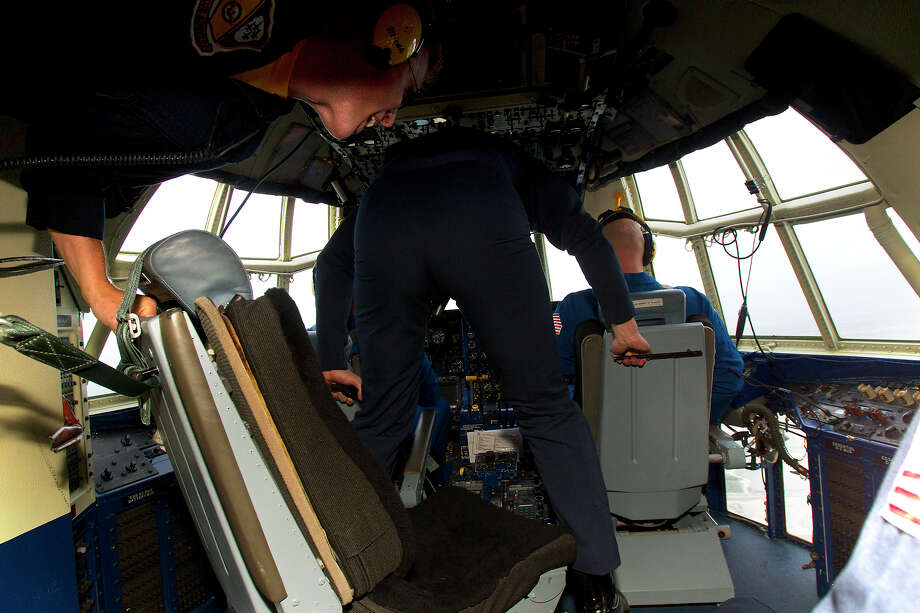 Marine Blue Angels, Gunnery Seargeant Micah Bachtold, left and Staff Seargeant Kevin Sanchez demonstrate zero gravity during a flight aboard the Blue Angel's Fat Albert C130 airplane at Ellington Field Friday, Oct. 26, 2012, in Houston. Photo: Cody Duty, Houston Chronicle / © 2012 Houston Chronicle