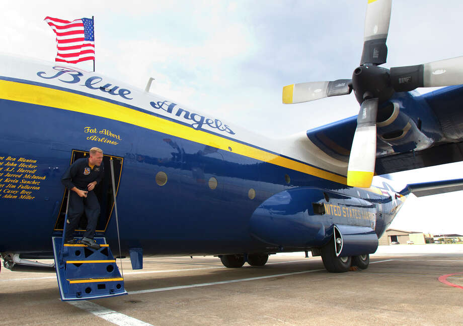 Marine Blue Angel Gunnery Seargeant Micah Bachtold deplanes the Fat Albert C130 airplane at Ellington Field Friday, Oct. 26, 2012, in Houston. Photo: Cody Duty, Houston Chronicle / © 2012 Houston Chronicle