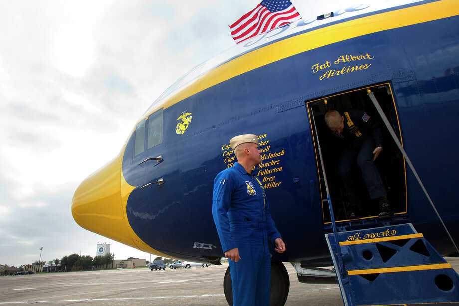 Marine Blue Angel Captain John Hecker, left, watches as Staff Seargeant Adam Miller, right, deplanes the Blue Angel's Fat Albert C130 airplane at Ellington Field Friday, Oct. 26, 2012, in Houston. Photo: Cody Duty, Houston Chronicle / © 2012 Houston Chronicle
