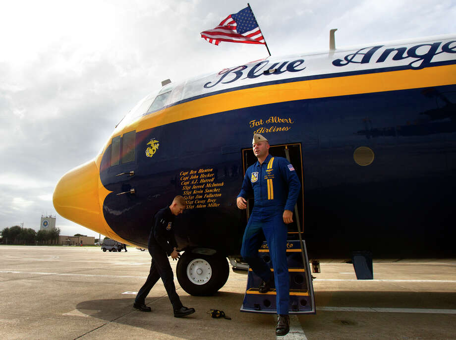 Marine Blue Angels Staff Seargeant Adam Miller, left, and Captain A.J. Harrell, right, deplane the Blue Angel's Fat Albert C130 airplane at Ellington Field Friday, Oct. 26, 2012, in Houston. Photo: Cody Duty, Houston Chronicle / © 2012 Houston Chronicle