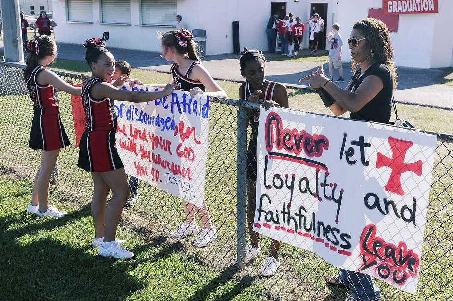 Kountze Middle School cheerleaders display their faith-based signs at a recent football game. Photo: Randy Edwards