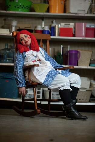 "Kaitlyn Humphrey models a ""Raggedy Anne doll"" costume at Seattle's Capitol Hill Value Village.Wig – $4.99Dress – $8.99 Shoes – model ownsLeggings – model owns