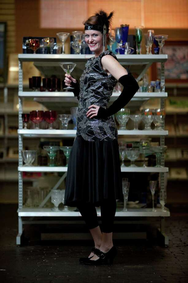 Valaree Rivera channels Daisy Buchanan from The Great Gatsby in this 1920s costume.Headpiece – $2.99Blouse – $6.99Skirt – $4.99Gloves – $2.99Shoes – $5.99About $24 Photo: JOSHUA TRUJILLO / SEATTLEPI.COM