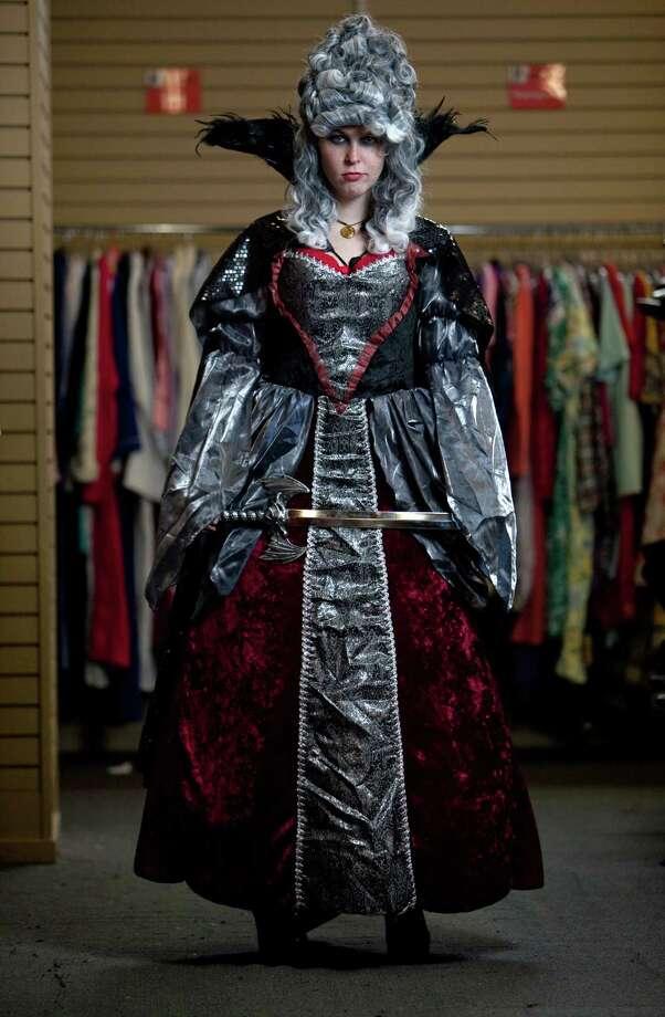 "Paige Ervin models an ""evil queen"" costume.Wig – $14.99Dress – $41.24Dagger - $5.99About $62 Photo: JOSHUA TRUJILLO / SEATTLEPI.COM"