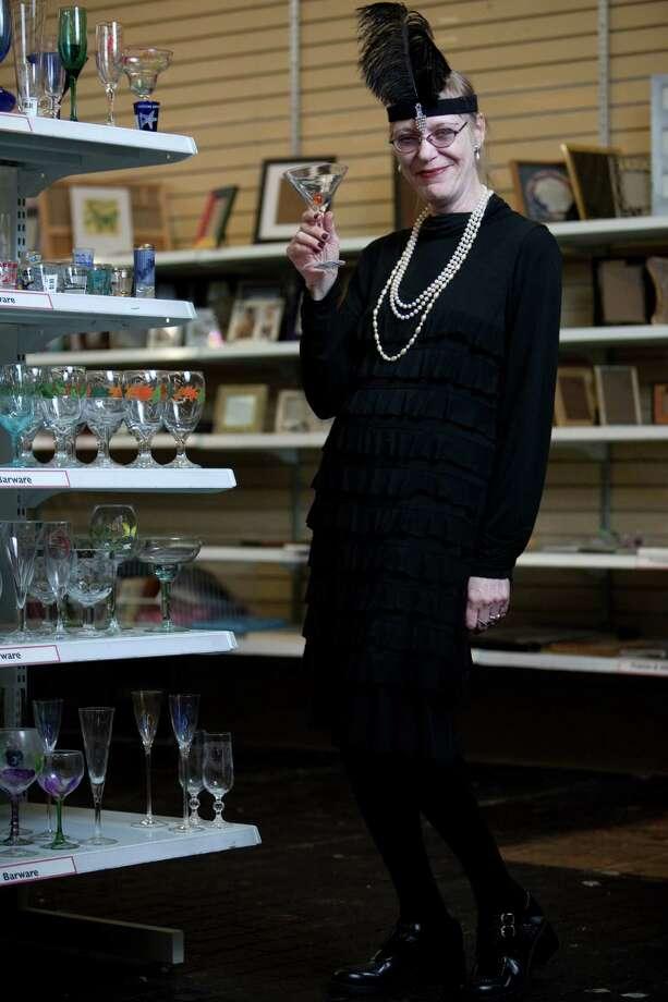 "Christy Soderstrom models a ""flapper"" costume.Headpiece – $2.99Necklace – $3.99Dress – $5.99Shoes - $5.99About $19 Photo: JOSHUA TRUJILLO / SEATTLEPI.COM"