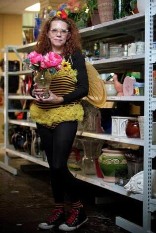 "Jacqualine Courtier models a ""bee"" costume.Bee leotard – $6.99Crown - $2.99Wings – $4.99Jeans and shoes – model ownsAbout $15 Photo: JOSHUA TRUJILLO / SEATTLEPI.COM"