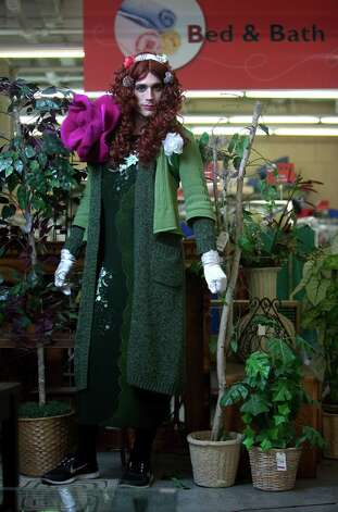 "Mark Perkins models a ""Poison Ivy"" costume.Wig – $8.99Sweater – $9.99Dress – $9.99Accessories – $5.99About $35 Photo: JOSHUA TRUJILLO / SEATTLEPI.COM"