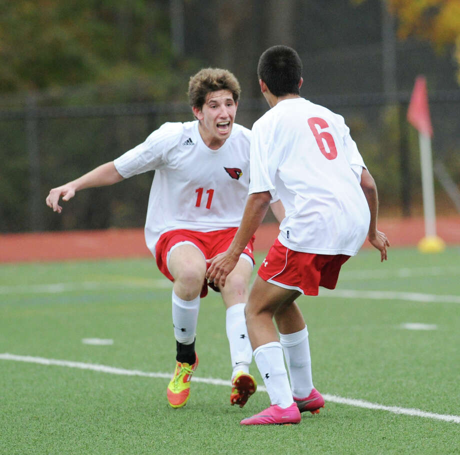 At left, Aidan Rafferty # 11 of Greenwich reacts after teammate, Joao Galbier, right, scored the second goal for his team during the second half of the FCIAC boys soccer quarterfinal match between Staples high School and Greenwich High School at Greenwich, Friday afternoon, Oct. 26, 2012. Greenwich advanced with a 3-0 win. Photo: Bob Luckey / Greenwich Time