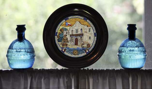 Detail of Alamo and Texas items in Sarah Reveley's dining room Thursday Oct. 25, 2012. (San Antonio Express-News)