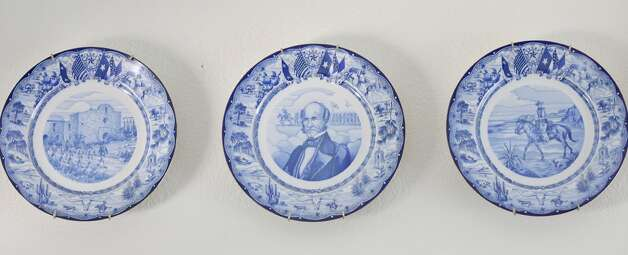 Detail of Texas Centennial collectible plates with the Battle of Goliad (from left), Sam Houston, and a Texas Ranger Thursday Oct. 25, 2012 at Sarah Reveley's home. (San Antonio Express-News)