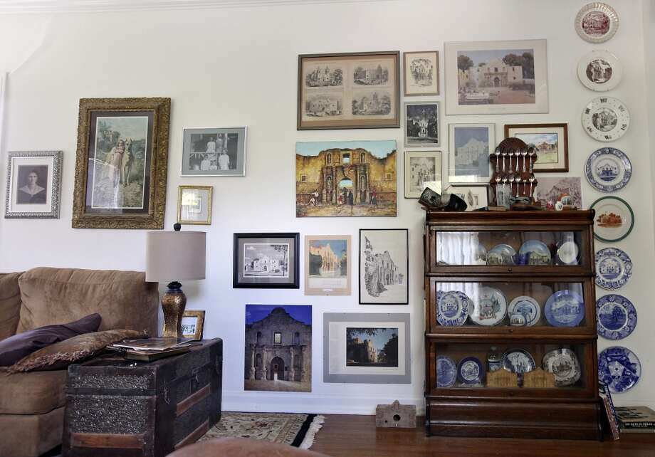 A view of a wall with Alamo and Texas items in Sarah Reveley's living room Thursday Oct. 25, 2012. (San Antonio Express-News)