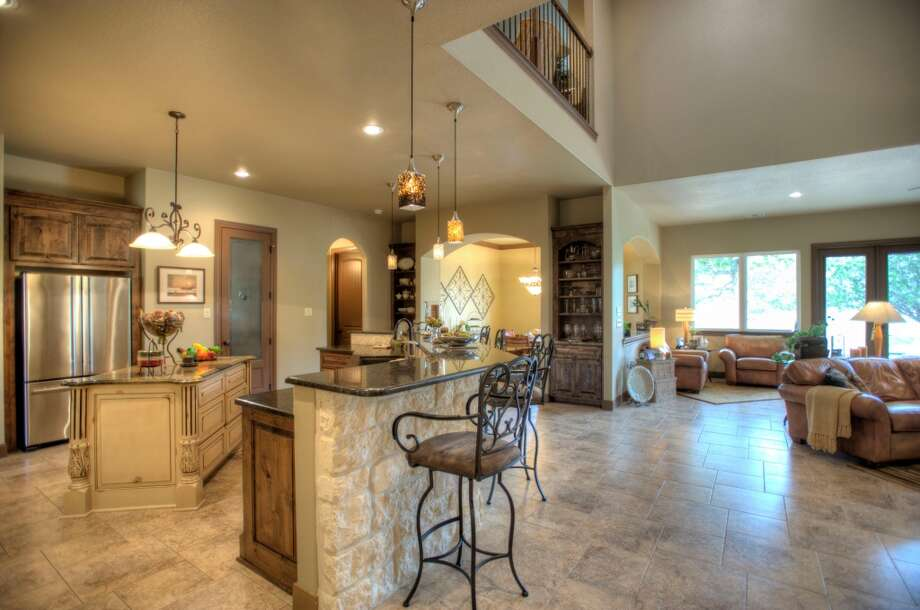 Great rooms that connect the kitchen and living areas continue to be popular with homebuyers, who tend to prefer a casual and informal home design. This five-bedroom, four-bathroom home at 8816 Jodhpur in Fair Oaks Ranch is listed for $624,500. (Courtesy photo)