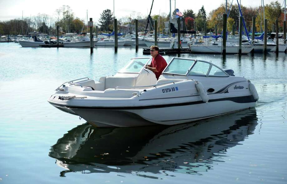 Paul Del Bene, of Fairfield, gets ready to take his boat out of the water Friday, Oct. 26, 2012 at South Benson Marina in Fairfield . Photo: Autumn Driscoll