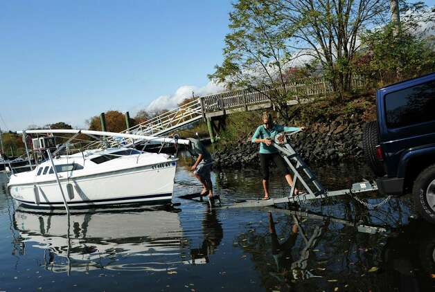 Ariane and Christian McMahan, of Fairfield, take their boat out of the water Friday, Oct. 26, 2012 at South Benson Marina in Fairfield. Photo: Autumn Driscoll