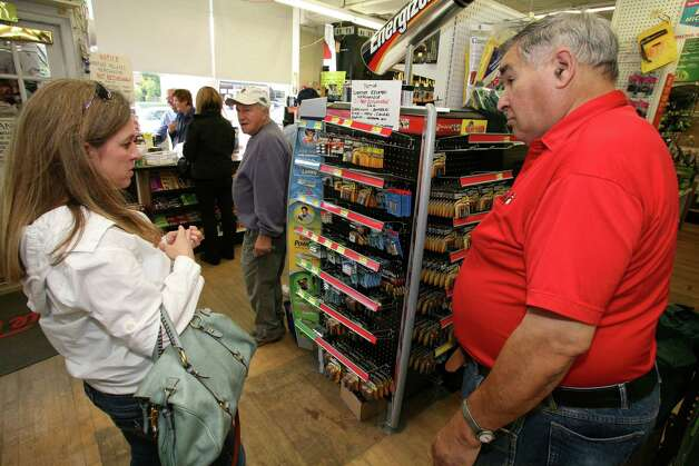 Fiensod Hardware manager Larry Weiner helps Alison Leigh select batteries Friday, Oct. 26, 2012, for Monday's possible storm. Photo: David Ames / Greenwich Time