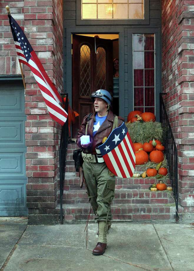 Dressed as Captain America from the movie Captain America: The First Avenger, Chauncey Roschbach, leaves his Pearland home for work where his is a senior information technology manager at a oil and gas equipment online auction company Friday, Oct. 26, 2012. Photo: Johnny Hanson, Houston Chronicle / © 2012  Houston Chronicle