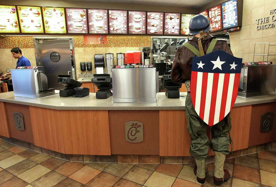 Dressed as Captain America from the movie Captain America: The First Avenger, Chauncey Roschbach, orders breakfast in Pearland before heading into work  where he is a senior information technology manager at a oil and gas equipment online auction company Friday, Oct. 26, 2012. Photo: Johnny Hanson, Houston Chronicle / © 2012  Houston Chronicle