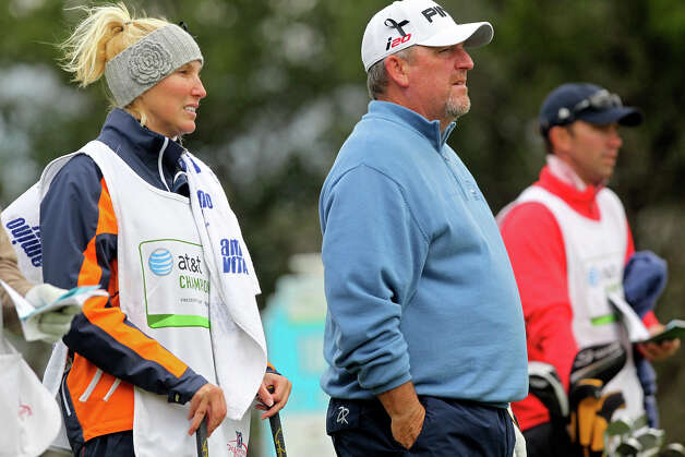 Mark Calcavecchia gets ready to play the 16th hole with caddy and wife Brenda during the 2012 AT&T Championship at the AT&T Canyons course on October 26, 2012. Photo: Tom Reel, Express-News / ©2012 San Antono Express-News