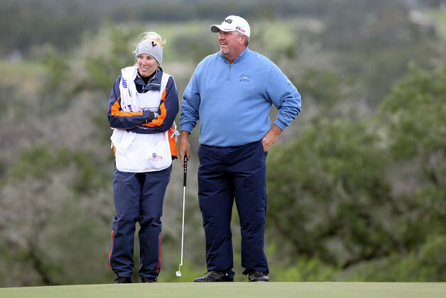 Mark Calcavecchia and caddy Brenda Calcavecchia watch players come up to the 17th green during the 2012 AT&T Championship at the AT&T Canyons course on October 26, 2012. Photo: Tom Reel, Express-News / ©2012 San Antono Express-News