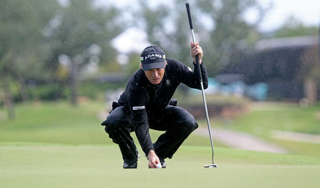 Bernhard Langer spots his ball on the first green during the 2012 AT&T Championship at the AT&T Canyons course on October 26, 2012. Photo: Tom Reel, Express-News / ©2012 San Antono Express-News