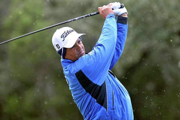 Tom Pernice, Jr. hits his tee shot on the second hole as rain falls during the 2012 AT&T Championship at the AT&T Canyons course on October 26, 2012. Photo: Tom Reel, Express-News / ©2012 San Antono Express-News