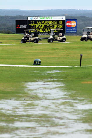 Golf carts are left on the course rest in front of a weather advisory during the 2012 AT&T Championship at the AT&T Canyons course on October 26, 2012. Photo: Tom Reel, Express-News / ©2012 San Antono Express-News