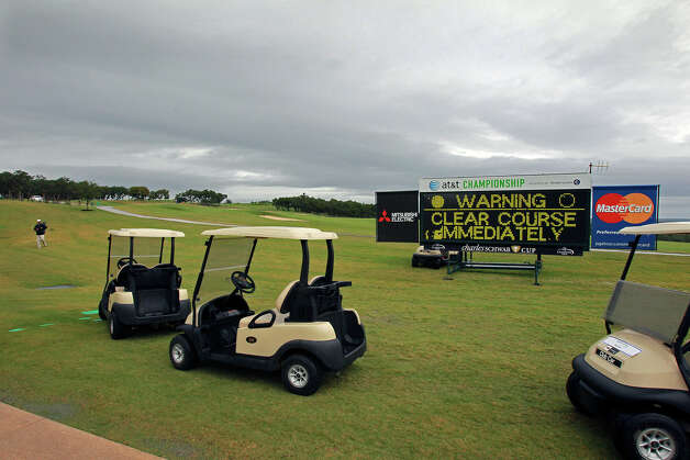 Play stops as a thunderstorm looms in the area during the 2012 AT&T Championship at the AT&T Canyons course on October 26, 2012. Photo: Tom Reel, Express-News / ©2012 San Antono Express-News