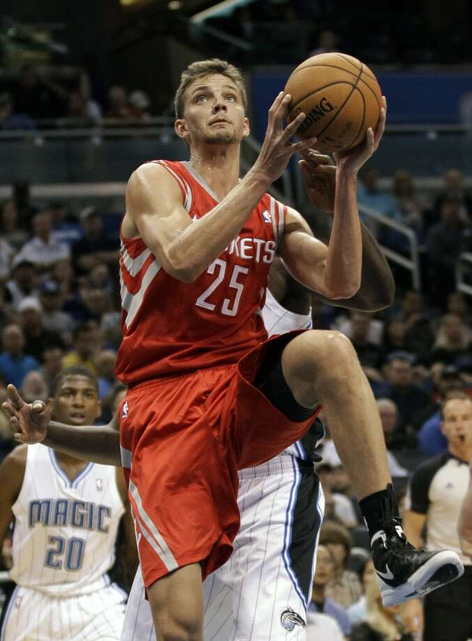 Rockets forward Chandler Parsons drives to the basket. (John Raoux / Associated Press)