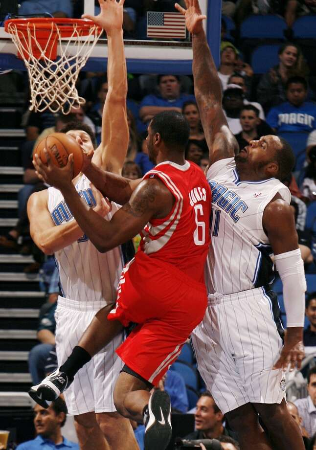 Rockets forward Terrence Jones is pressured by Magic defenders. (Stephen M. Dowell / Orlando Sentinel/MCT)