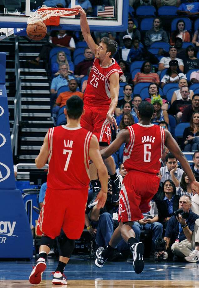 Rockets forward Chandler Parsons throws down an emphatic uncontested dunk. (Stephen M. Dowell / Orlando Sentinel/MCT)