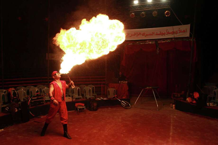 Rifat al-Gureisy, 55, a member of the Egyptian National Circus blows fire during a practice in Gaza City, Thursday. The circus put on its first show of a month-long visit to Gaza on Friday. Photo: Adel Hana, STF / AP