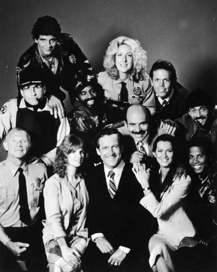 """Long before TV got really dumb with the Kardashians and Honey Boo Boo, there was """"Hill Street Blues,"""" a smart drama shouldered by Daniel J. Travanti and Veronica Hamel as cerebral babe lawyer Joyce Davenport. She's second from right in the front. The series ran from 1981 to 1987.  Photo: NBC Television, . / 2003 Getty Images"""