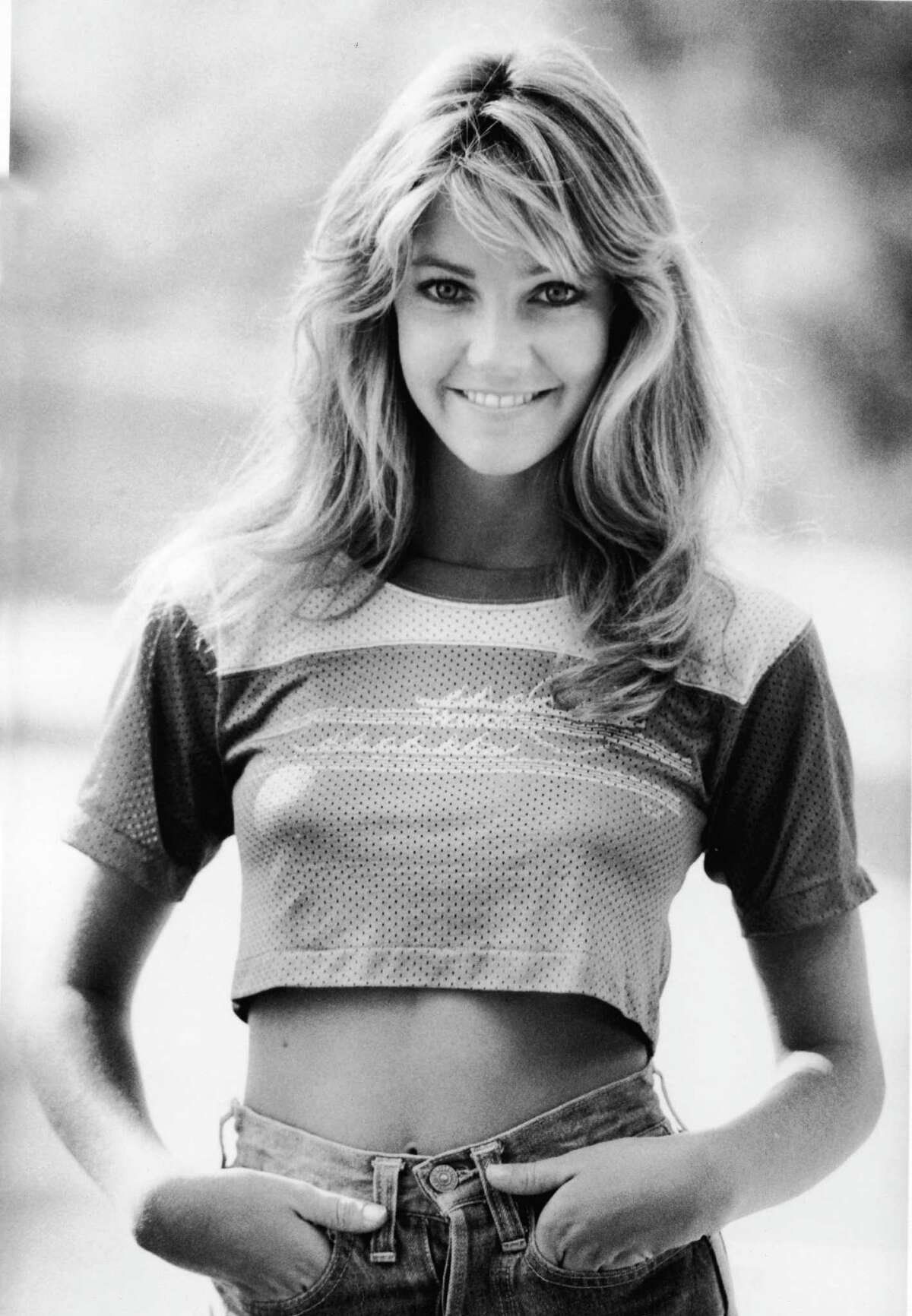 Welcome to the '80s, a great time of actresses with big hair, shoulder pads and ripped sweatshirts. We start with Heather Locklear, best known as catty Amanda Woodward from