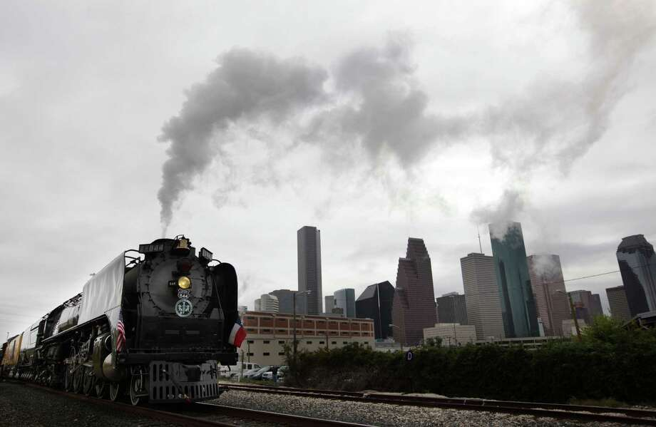 Union Pacific Steam Train arrives to Downtown Houston to kick off the Union Pacific Railroad's 150th Anniversary on Friday, Oct. 26, 2012, in Houston. On Saturday, the public is welcome to celebrate 150th anniversary by touring Union Pacific's new traveling museum exhibit car, free rides on the miniature train, and Union Pacific giveaways. Photo: Mayra Beltran, Houston Chronicle / © 2012 Houston Chronicle