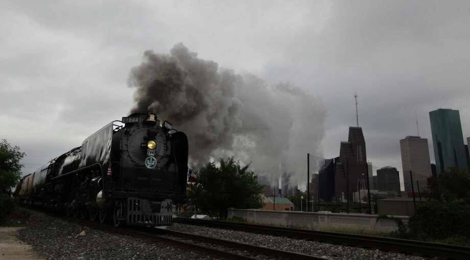 Union Pacific Steam Train arrives to Downtown Houston to kick off the Union Pacific Railroad's 150th Anniversary on Friday, Oct. 26, 2012, in Houston. Photo: Mayra Beltran, Houston Chronicle / © 2012 Houston Chronicle