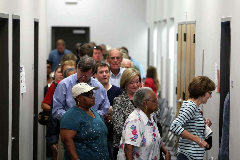 Voters line up to during early voting at the Harris County Precinct 3 Trini Mendenhall Sosa Community Center Friday, Oct. 26, 2012, in Houston. The numbers of voters were so great at the location, some had to wait more than an hour to vote. Photo: Johnny Hanson, Houston Chronicle / © 2012  Houston Chronicle