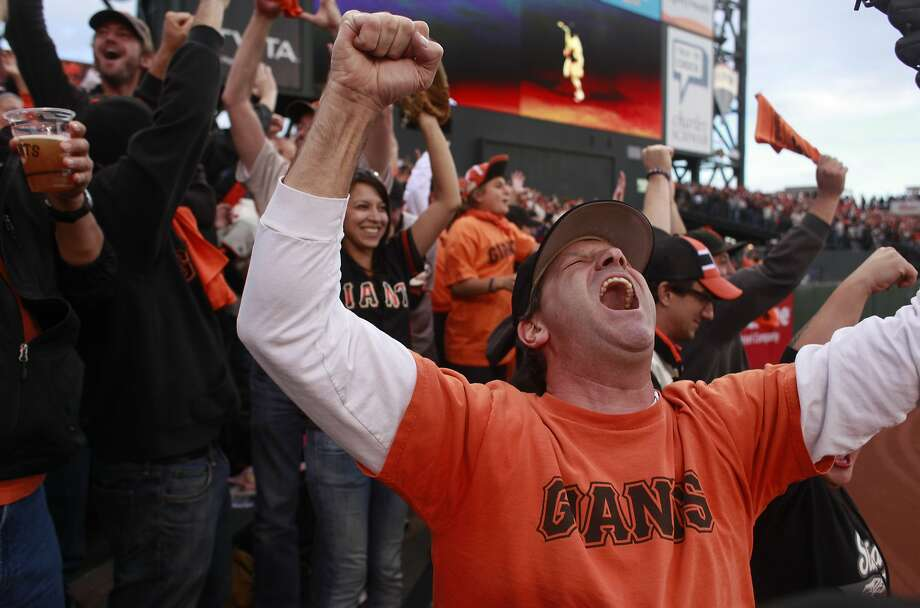 Michael Lepides, of Sunnyvale, throws his hands up after Pablo Sandoval hit his first home run in the first inning on Game One of the San Francisco Giants World Series against the Detroit Tigers on Wednesday Oct. 24, 2012 in San Francisco, Calif. Photo: Mike Kepka, The Chronicle