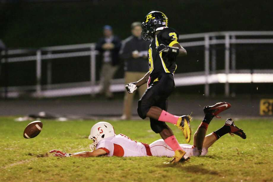 """Mike Ross Connecticut Post freelance - Fairfield Prep""""s # 6 David Gerics cant handle a long pass aginst Amity High School's # 3 Cory Ricks during Friday evening game. Photo: Mike Ross"""