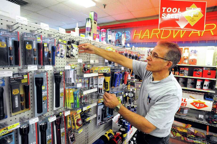 Jack Deep stocks batteries and flashlights at Deep's Hardware in Danbury Thursday, Oct. 25, 2012. He has placed emergency orders for storm-related items in anticipation of Hurricane Sandy's arrival. Photo: Michael Duffy