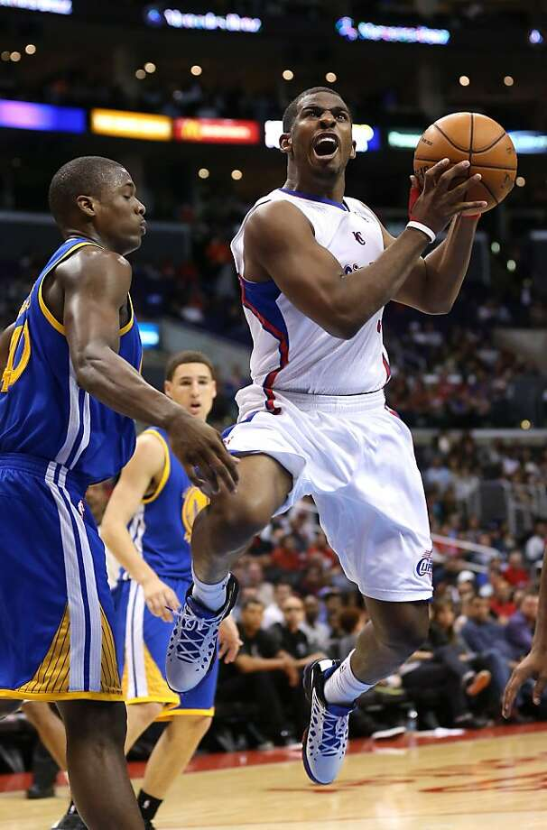 The Clippers' Chris Paul (right) has been bothered by an injury to his right thumb. Photo: Stephen Dunn, Getty Images