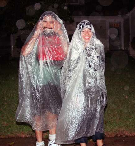 A couple walking in the down pour of Hurricane Floyd Thursday Sept 16, 1999 Photo: File Photo\Douglas Healey