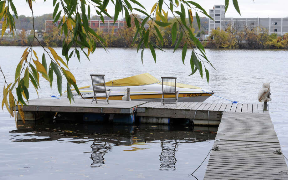 A boat is docked along the Hudson River on Friday, Oct. 26, 2012 in Rensselaer, N.Y. Boaters taking advantage of warm fall weather who still have their vessels docked should act now to secure them in advance of anticipated high winds and heavy rains from Hurricane Sandy. (Lori Van Buren / Times Union) Photo: Lori Van Buren
