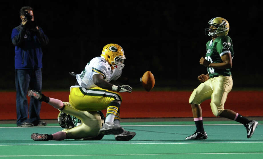 Trinity Catholic's #35 Sean Brown lands in the endzone for a touchdown, during boys football action against Bassick in Bridgeport, Conn. on Friday October 26, 2012. Photo: Christian Abraham