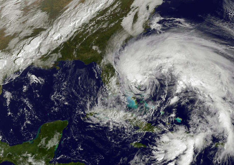 A satellite image shows Hurricane Sandy's huge cloud extent of up to 2,000 miles while centered over the Bahamas. Funding shortfalls and aging equipment may soon leave the U.S. blind in its weather forecasting. Photo: HO, Handout / AFP