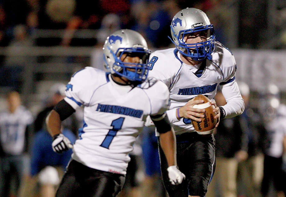 10/26/12: Jordan Wood #8 and Michael Hill #1 of the Friendswood Mustangs play the option against the Dawson Eagles at the RIG in Pearland, Texas. Dawson lead 21 to 20 at half. Photo: Thomas B. Shea, For The Chronicle