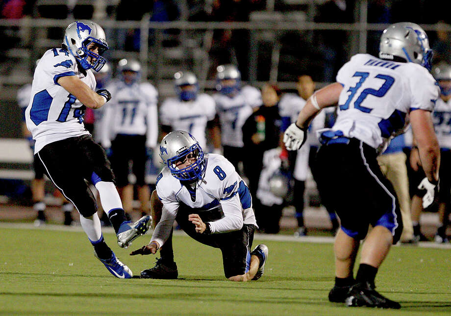10/26/12: Michel Montalvo #14 of the Friendswood Mustangs kicks a 31 yard field goal against of the Dawson Eagles in the closing seconds of the first half at the RIG in Pearland, Texas. Dawson lead 21 to 20 at half. Photo: Thomas B. Shea, For The Chronicle