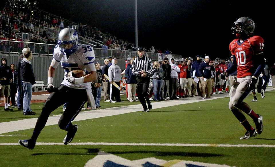 10/26/12: Walker Williams #35 of the Friendswood Mustangs scores on a 21 yard touchdown reception ag