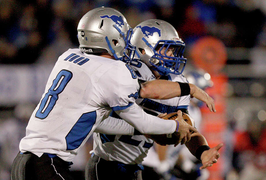 10/26/12: Jordan Wood #8 and Sam Longbotham #25 of the Friendswood Mustangs play the option against the Dawson Eagles at the RIG in Pearland, Texas. Dawson lead 21 to 20 at half. Photo: Thomas B. Shea, For The Chronicle
